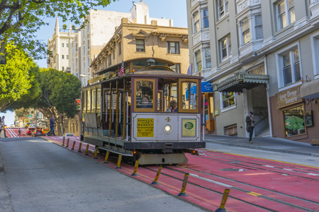 Passenger riding on a famous San Francisco cable car
