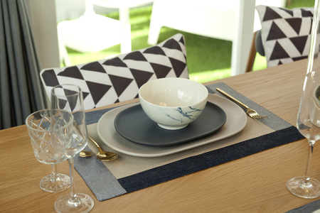 Table set on wood dinning table at home, Modern dinning room Stock Photo
