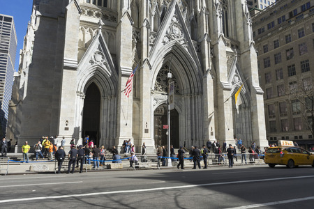 Crowded of tourist in front of St. Patrick's Cathedral on 5th avenue in Manhattan, NYC