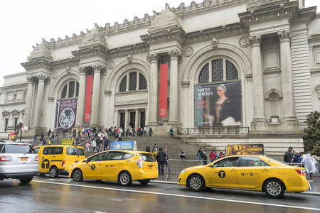 Crowded of tourist walking in front of The Metropolitan Museum on a Rainy Day in New York City