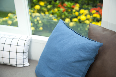View of comfortable modern corner couch sofa with many pillows outside on loft balcony Stock Photo