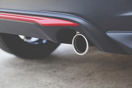 Close up detail exhaust pipe of a car.
