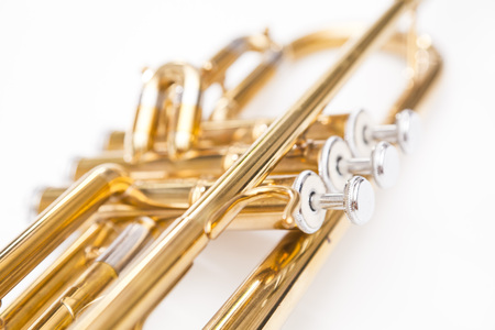Close up of trumpet on white background. Detail of old trumpet instrument. 写真素材