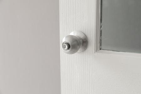 metal knob of white wood door Stok Fotoğraf