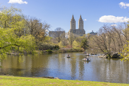 People boating in The lake at Central Park on nice weather day in New York City,USA