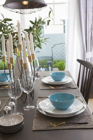 Modern dinning room interior with blue plate on wood table at home. Stock Photo - 117520218