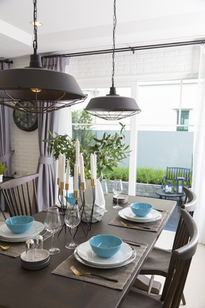 Modern dinning room interior with blue plate on wood table at home. Stock Photo - 117521218
