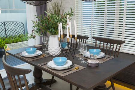 Modern dinning room interior with blue plate on wood table at home. Stock Photo - 117521220