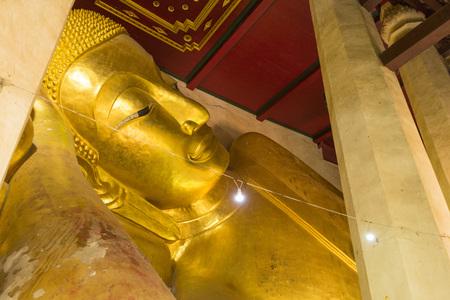 The famous reclining Buddha in Buddhist church in Phetchaburi, Thailand Reklamní fotografie