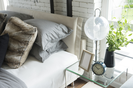 modern table lamp on side table in bedroom.