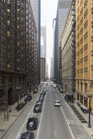 The view of Chicago downtown with street and hi-rise building view from elevated train station in Chicago,USA