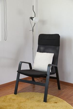 Scandinavian space to relax black armchair Stock Photo