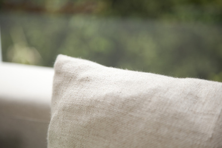 Pillow in grey color on a couch,close up. Standard-Bild - 122185629