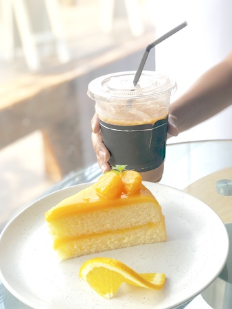orange cake dish in coffee shop