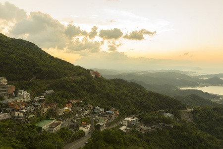 Panoramic view of Hillside Jiufen old village with blue sky in New Taipei City, Taiwan