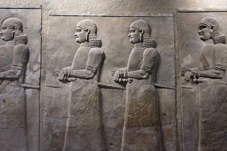 Ancient Sumerian stone carving on wall, bas relief on wall.