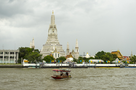 Wat Arun Temple at sunset in Bangkok, Thailand.