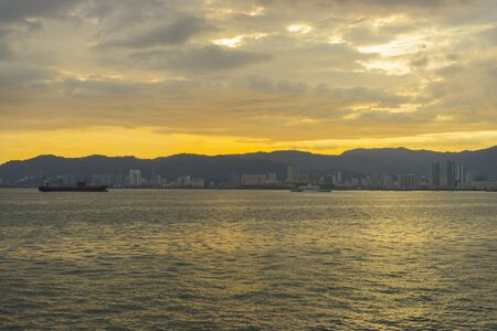 Georgetown cityscape at sunset in Penang, Malaysia.