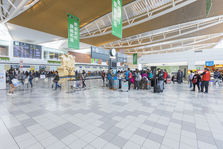 Chitose, Hokkaido,Japan - March 6,2019 : Crowed of tourists at departure hall of the New Shin Chitose airport in Hokkaido,Japan on March 6,2019. Editoriali
