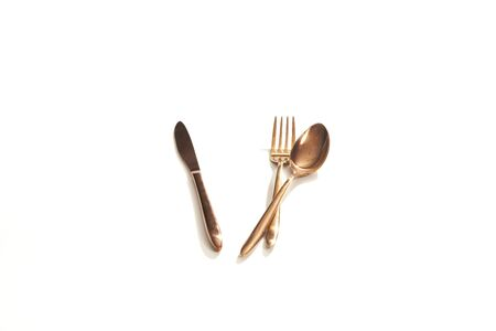 spoon and fork isolated over the white background