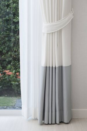 Close up of white modern curtain detail of Holder, interior detail.
