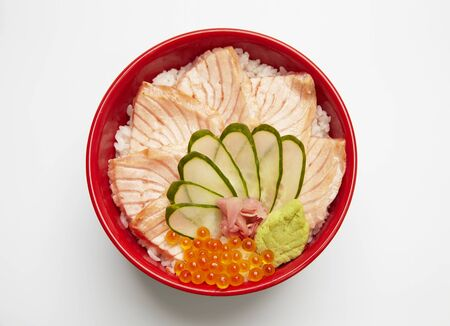 Salmon don, japanese rice bowl topped with burn salmon slices.