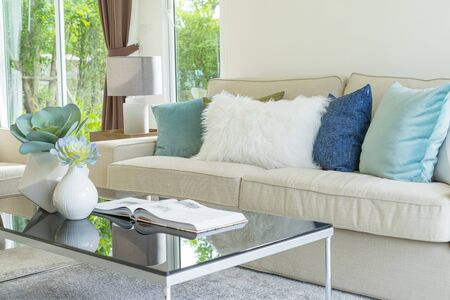 detail image of colorful cushion on sofa, living room, modern house, home decoration Archivio Fotografico