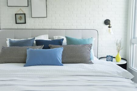 White and blue spacious bedroom with a large bed, in the Scandinavian style. Mockup and free space for text and pictures