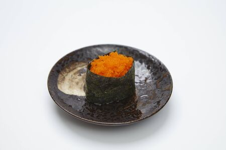Ikura Salmon Roe Gunkan Maki Sushi isolated on white background. Japanese cuisine.
