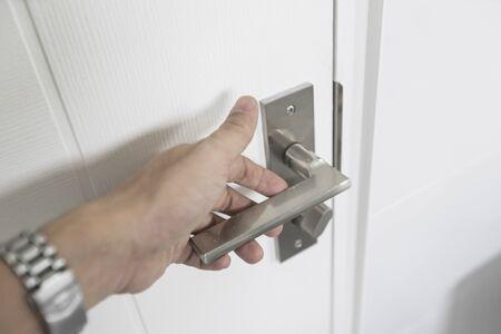 Hand is Holding Door Knob While Opening a Door