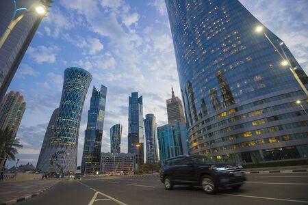 Futuristic modern skyscrapers in financial district at twilight in Doha, Qatar