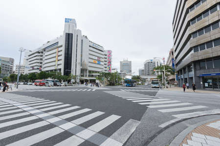 Street view of intersection in front of RYUBO Department Store in Naha, Okinawa, Japan