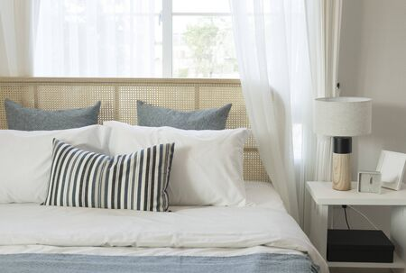 The bedroom in a Scandinavian minimalist natural style. Gray pillows on the bed. Banque d'images