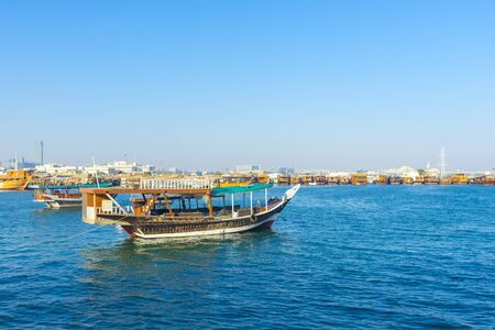 Traditional boats called Dhows are anchored in the port near Museum of Islamic Art Park,Doha, Qatar.