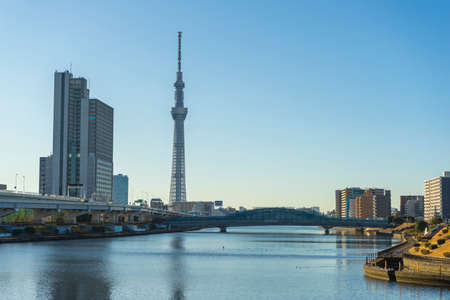 Tokyo Skytree with blue sky background and Sumida river as foreground in Tokyo, Japan
