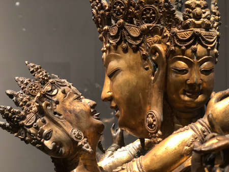 The gilded four-armed form of Avalokiteshvara Buddha statue in museum.