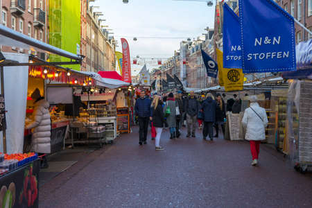 People shopping at Albert Cuyp Market in Amsterdam, Netherlands