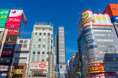 Street view of building and sign board of Shinjuku ward in Tokyo, Japan
