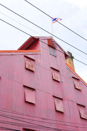Main building of Red rise mill in Songkhla old town, known as Hub Ho Hin rice mill in Songkhla, Thailand.