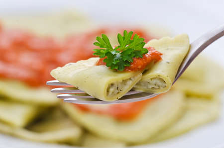 Sliced ravioli on a fork