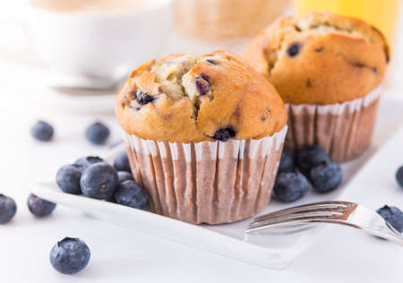 Blueberry muffins with a breakfast setting