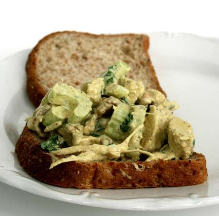 Open faced chicken salad sandwich on whole-wheat bread