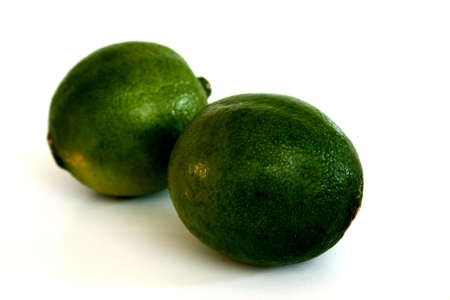 Two ripe organic limes that were freshly picked
