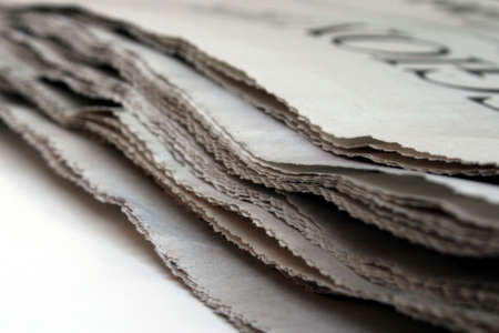 A daily newspaper from the side with a shallow depth of field