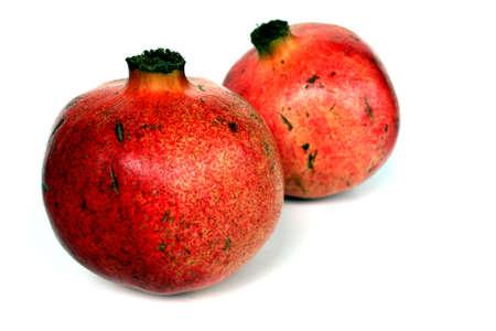 Two pomegrantates