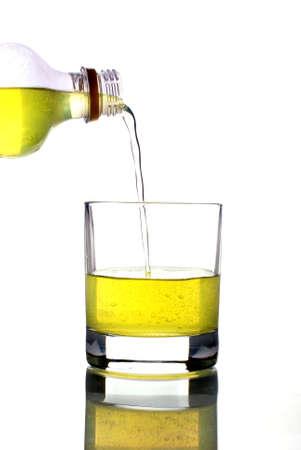 sugary: pouring fruit juice into a glass mug