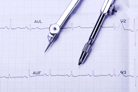 EKG printout and compasses under  monochromatic source photo