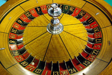 An old Roulette wheel with a silver center