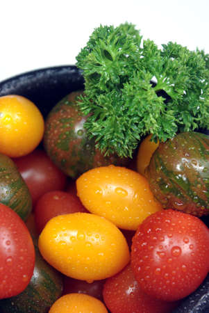 Three different variaties of cherry tomatoes, red, yellow pear and stripped green.