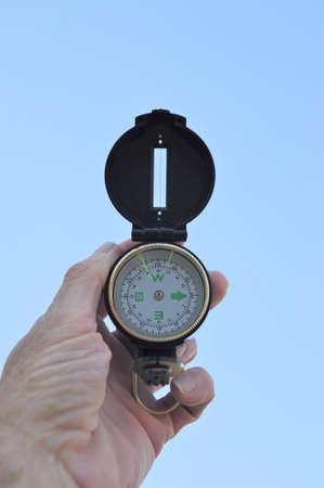 A black lensatic compass and light blue sky Stock Photo - 3820999